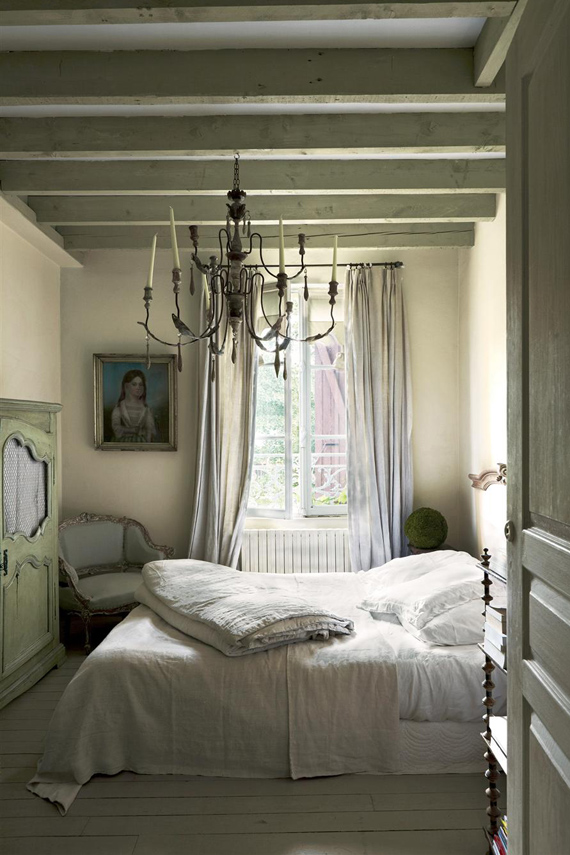 Bedroom painted in Farrow & Ball Ball Green.