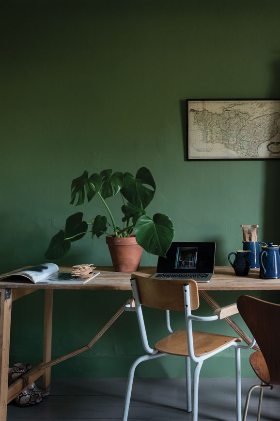 Green study with wooden desk painted in Calke Green