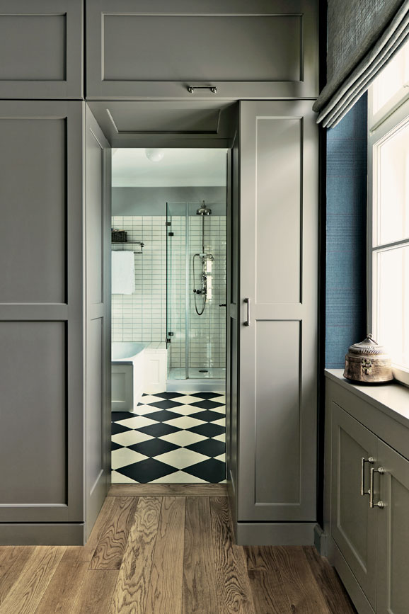 Hallway with wood panelling painted in Charleston Gray
