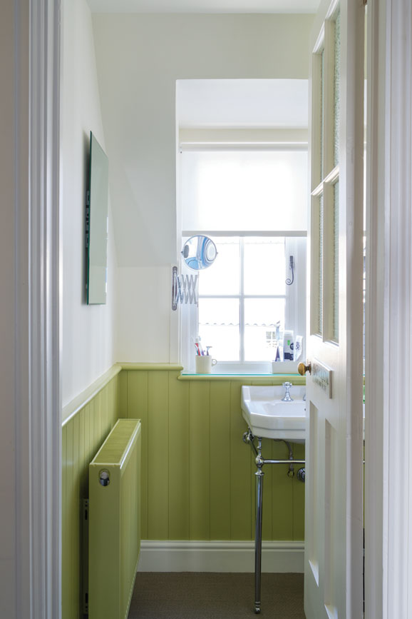 Bathroom with wood panelling painted in Churlish Green
