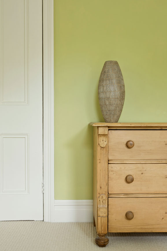 Bedroom wall painted in Churlish Green