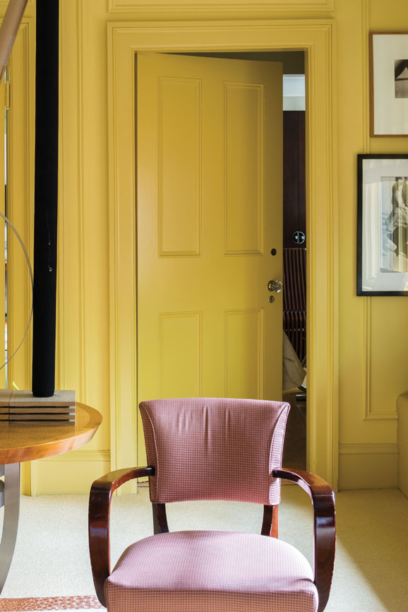 Living room with yellow wood panelling painted in Citron