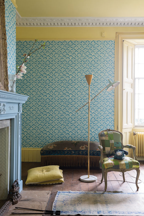 Living room painted in Dayroom Yellow with Aranami wallpaper