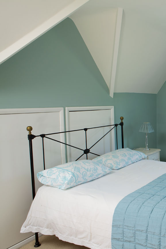 Bedroom painted in Green Blue