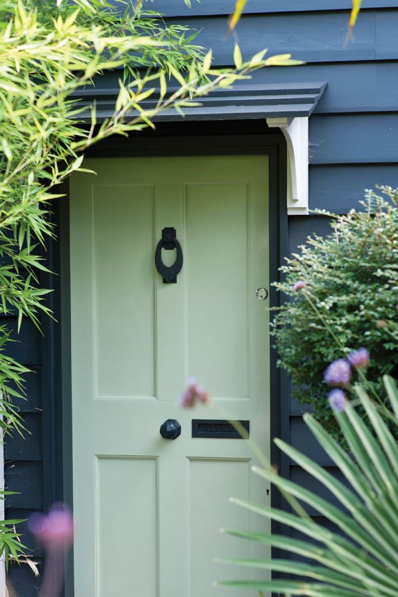 Front door painted in Green Ground
