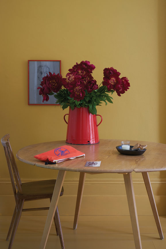 Dining room painted in India Yellow