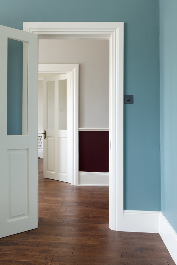 Hallway painted in Oval Room Blue.